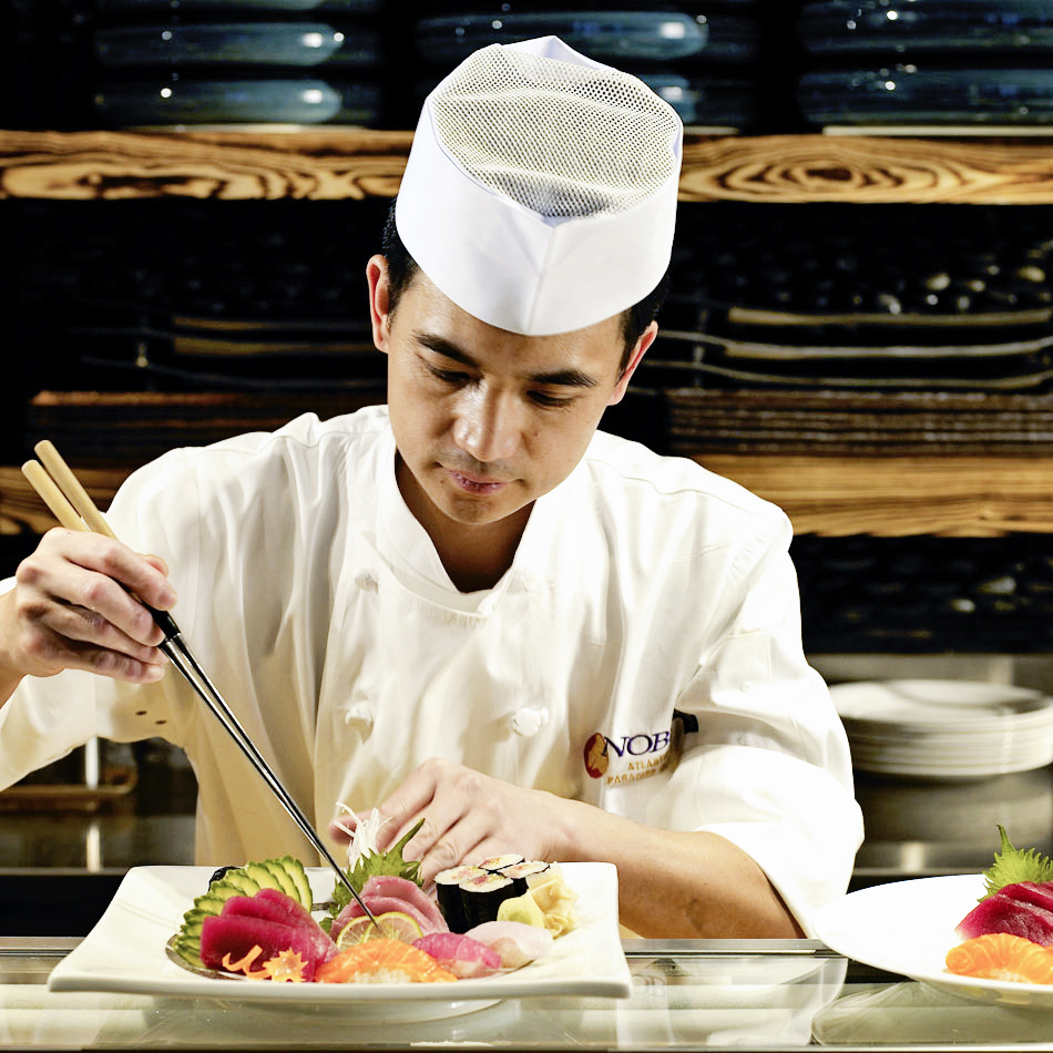 A Nobu Sous Chef showing the art of a beautiful presentation. Wow!