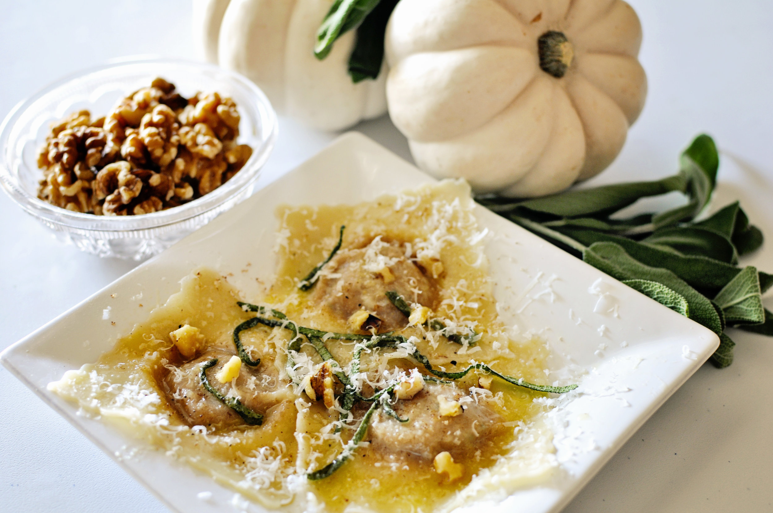 Pumpkin Ravioli   with brown butter, sage and toasted walnuts