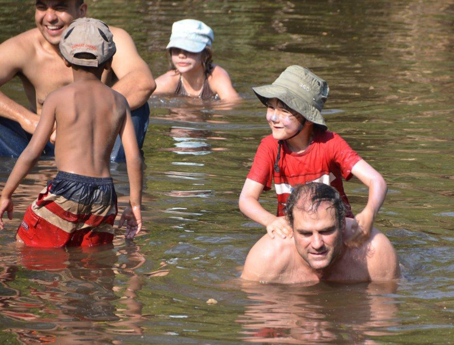 Kids and big kids having fun in the natural swimming pool