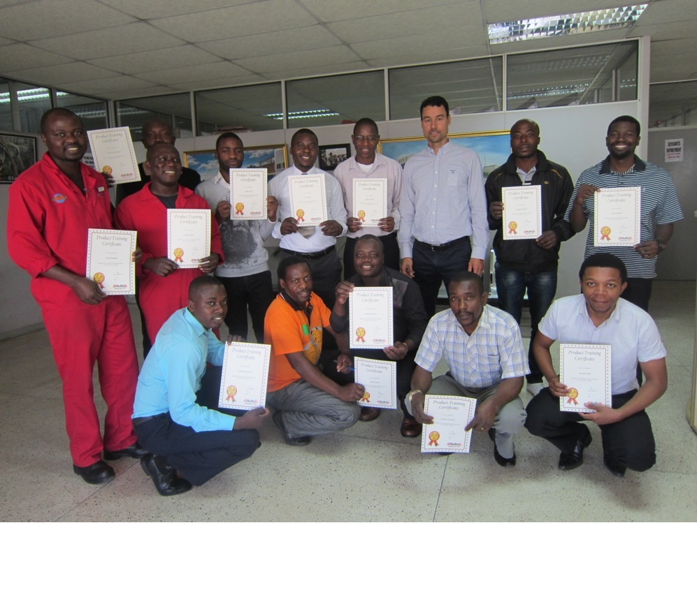 The 12 certificate-holders proudly show of their certificates, with Glenn Findlay, Autoworld Director, and Mr Phiri of Holts.