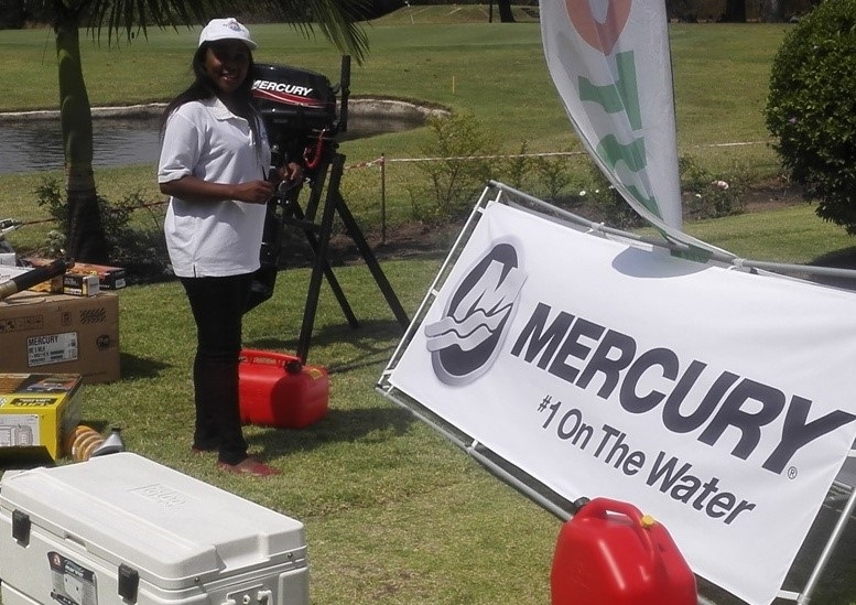 Miriam of Autoworld Kitwe with some of the products on display at the 18th hole