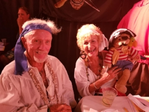 Long time theater patrons Marty and Carol Tuohy dress the theme for a past Whodunnit!