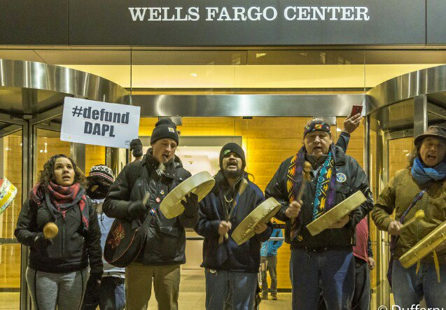 Rachel Heaton, Matt Remle, Jesse Nightwalker, Raymond L. Kingfisher and Paul Cheoketen Wagner outside of the Wells Fargo Center in downtown Seattle, January 5th 2017. Photo courtesy of John Duffy.