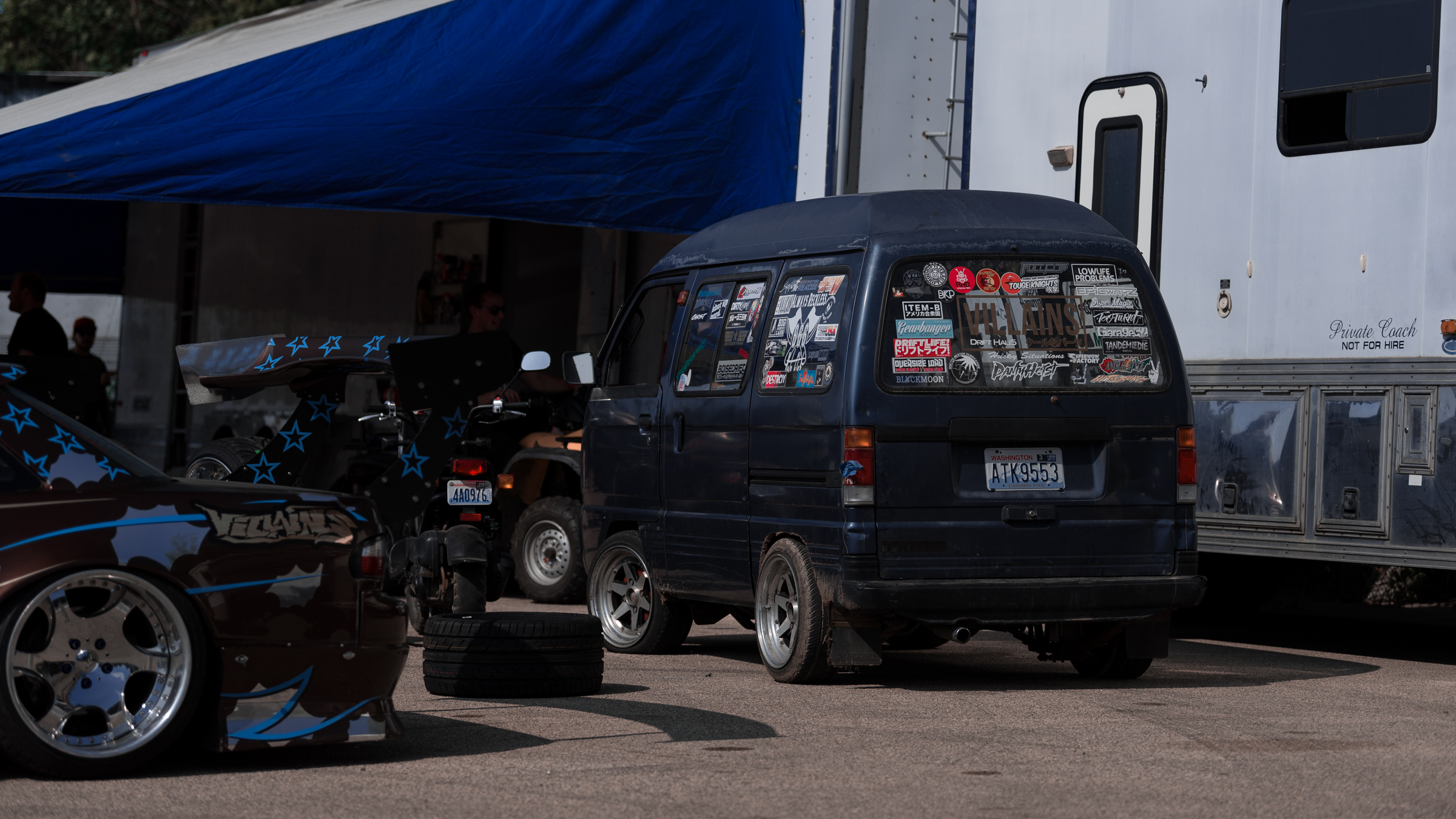 Villains unpacking their trailer and getting their extreme wide body D-machines ready.