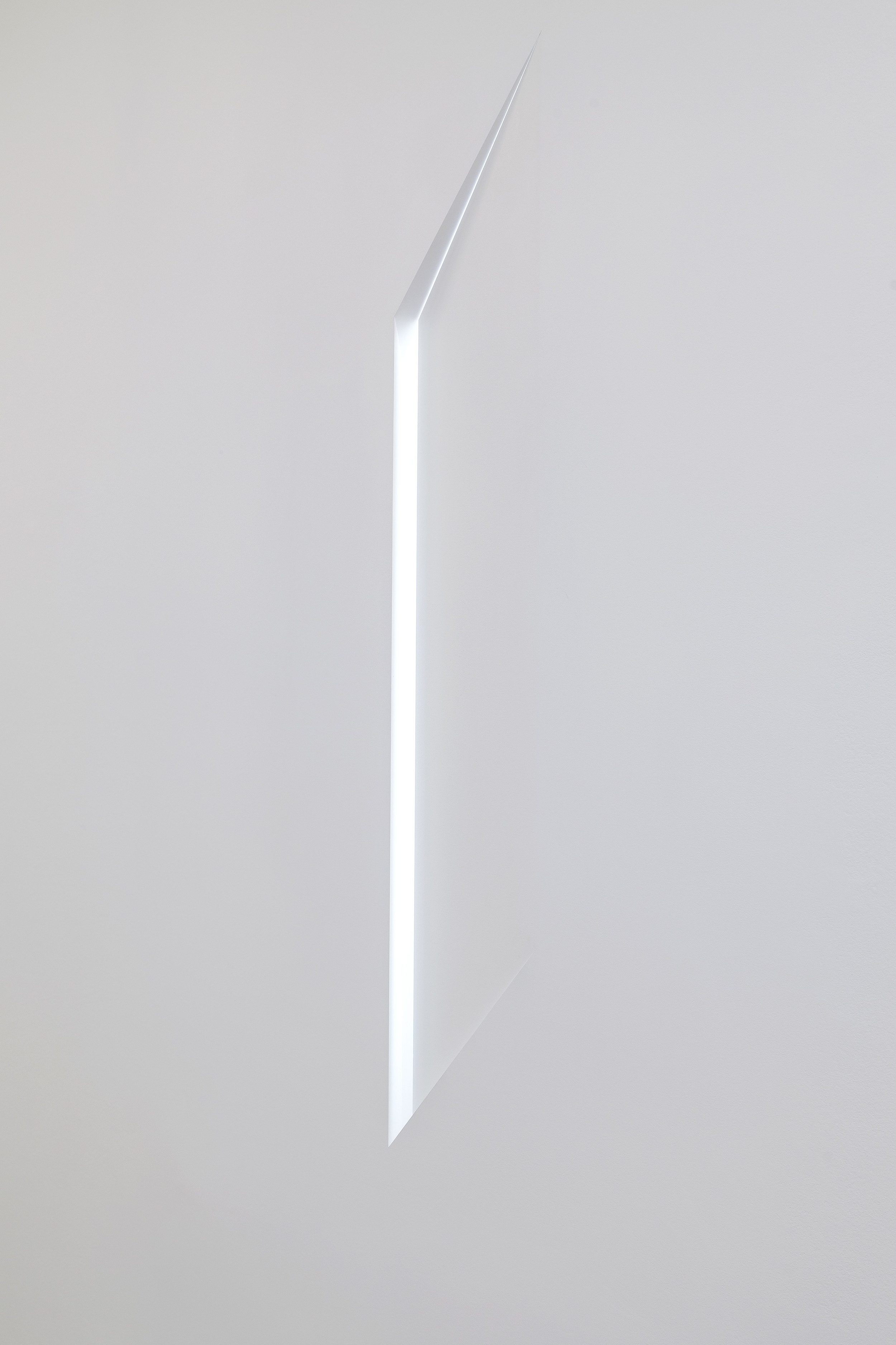 Disclosed Light. Installation constructed into existing wall, revealing and bringing the daylight from a hidden window behind the wall into the galleryspace.