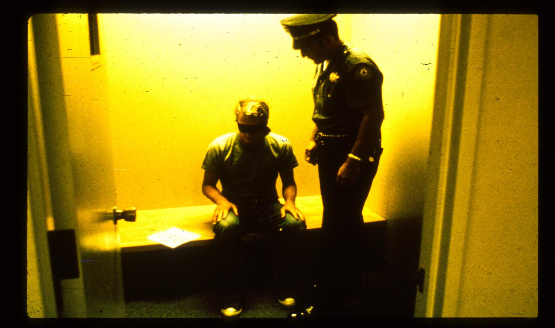 Police Blindfolding Prisoner