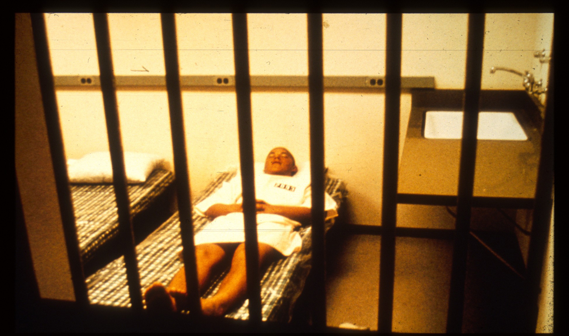 Prisoner Resting in Cell