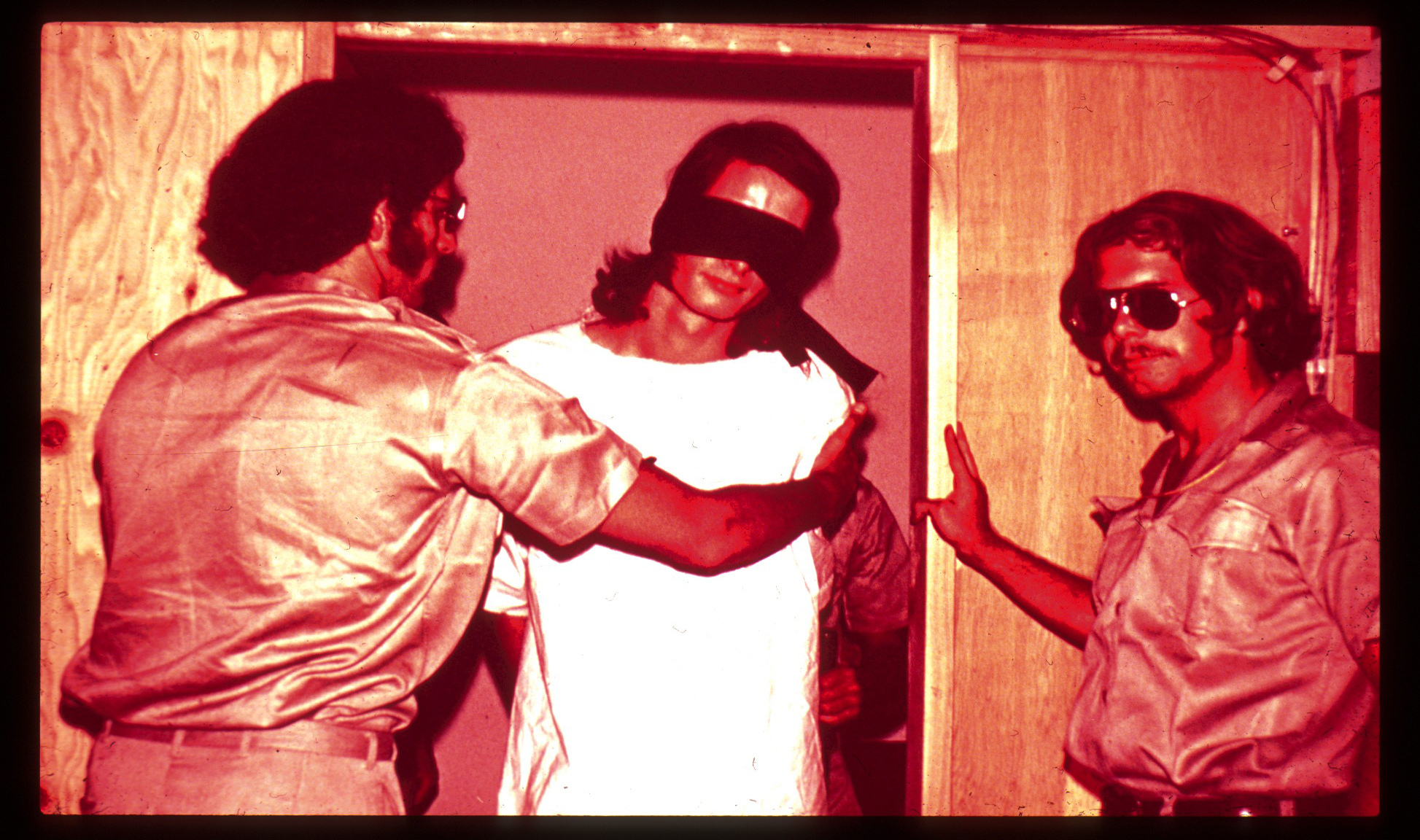 Guards with Blindfolded Prisoner