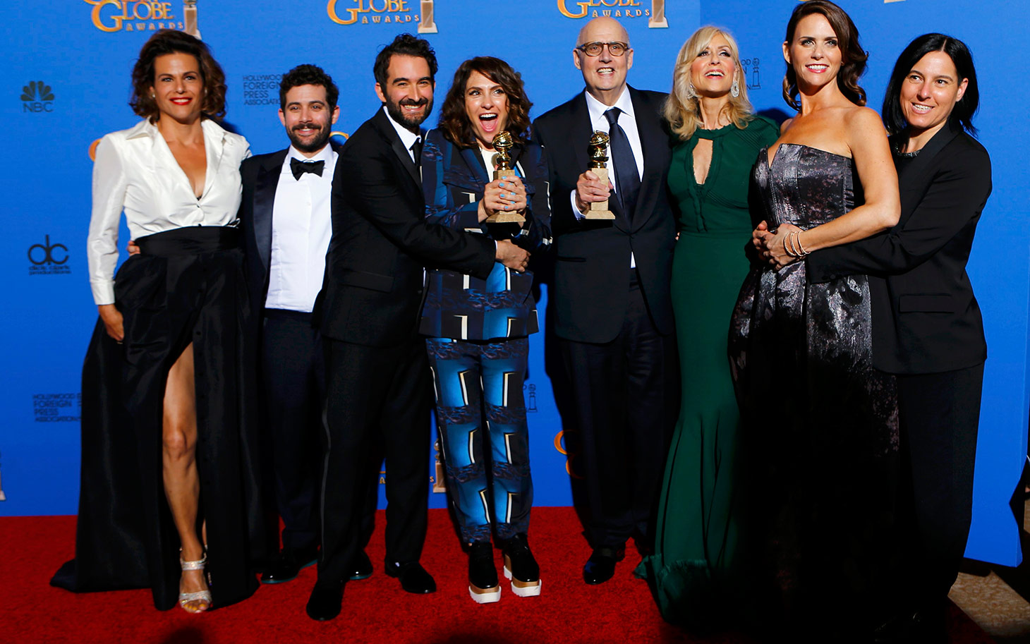 """The cast of """"Transparent"""" poses with their award at the 72nd Golden Globe Awards in Beverly Hills"""