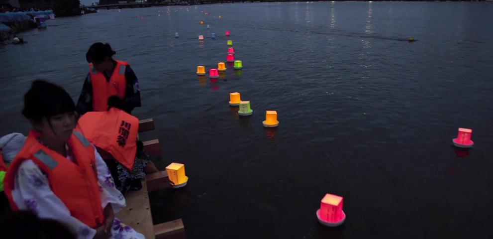 Touronagashi: floating lanterns in honor of ancestral spirits, an Obon tradition. Photo (c)2011 Stu Levy.