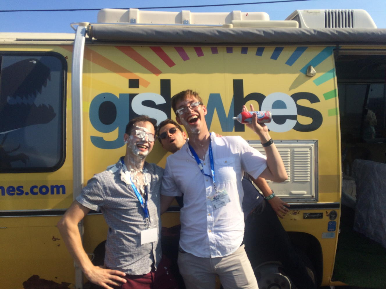 Outside the Gishbus, Random Acts volunteers show the aftermath of a whipped cream fight!