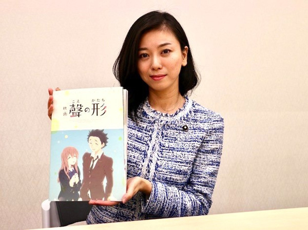 MP Eri Saito, with a copy of the manga version of  A Silent Voice.