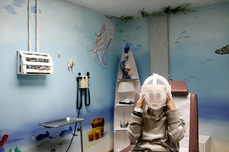 Ethan Arbelo, 11, plays with a radiotherapy mask given to him after completing the last of 28 sessions of radiation at Florida Hospital on May 2, 2013 in Tampa, Fla. Doctors believe that he could expect to live another nine months.