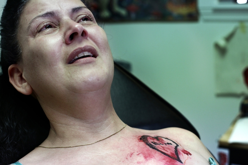"On July 5, 2014, two days after Ethan Arbelo died, Maria Maldonado receives a tattoo at Ink Cafe in Cape Coral, Fla, of a drawing Ethan made with their initials just before losing movement in his hands. ""This way he is always with me,"" Maria said."