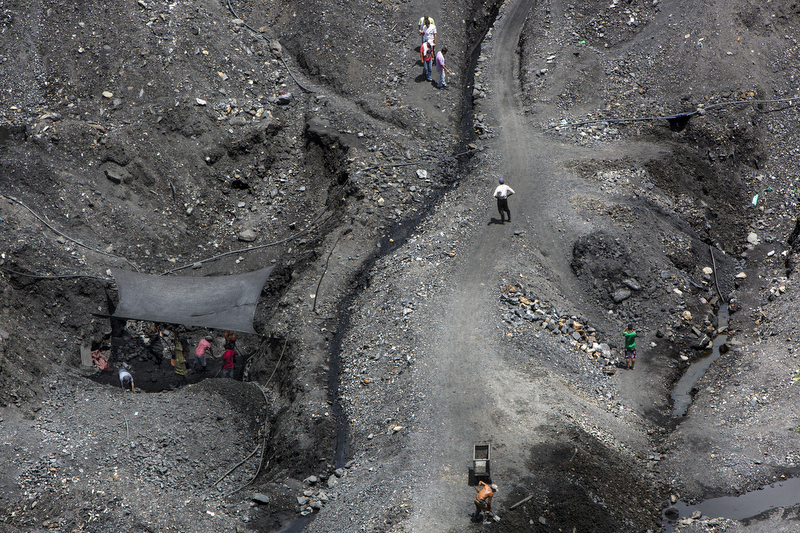 """Guaqueros,"" independent mines laborers dig through a was just outside the Minería Texas Colombia pant in search of emeralds in the municipality of Muzo, department of Boyacá, in Colombia on July 24, 2015."