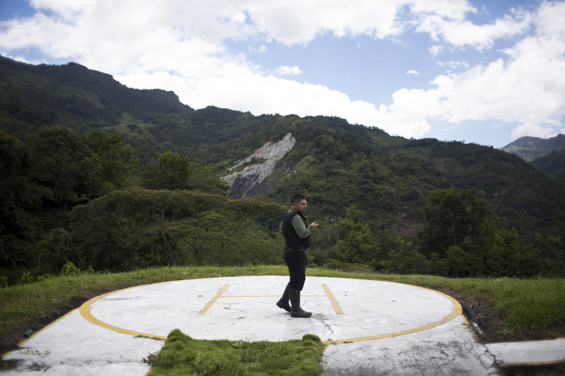 A security guard keeps watch on the property where Victor Carranza lived while he controlled much of Colombia's emerald business in the department of Boyacá, Colombia on July 24, 2015. In 2013, Minería Texas Colombia purchased the mine once owned by the late Victor Carranza. -- This project was originally commissioned for the Washington Post.