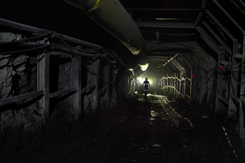 An emerald miner employed by the US owned Minería Texas Colombia, MTC, walks down a mining shaft in Muzo, on July 24, 2015. MTC is the first foreign investor involved in the trade in Colombia. The search for emeralds comes at a cost. The history is bloodstained. Thoughts of people in the 80s were killed during the Green Wars and today there is a sense of ownership to the land and its riches which foreigners are now profiting from.
