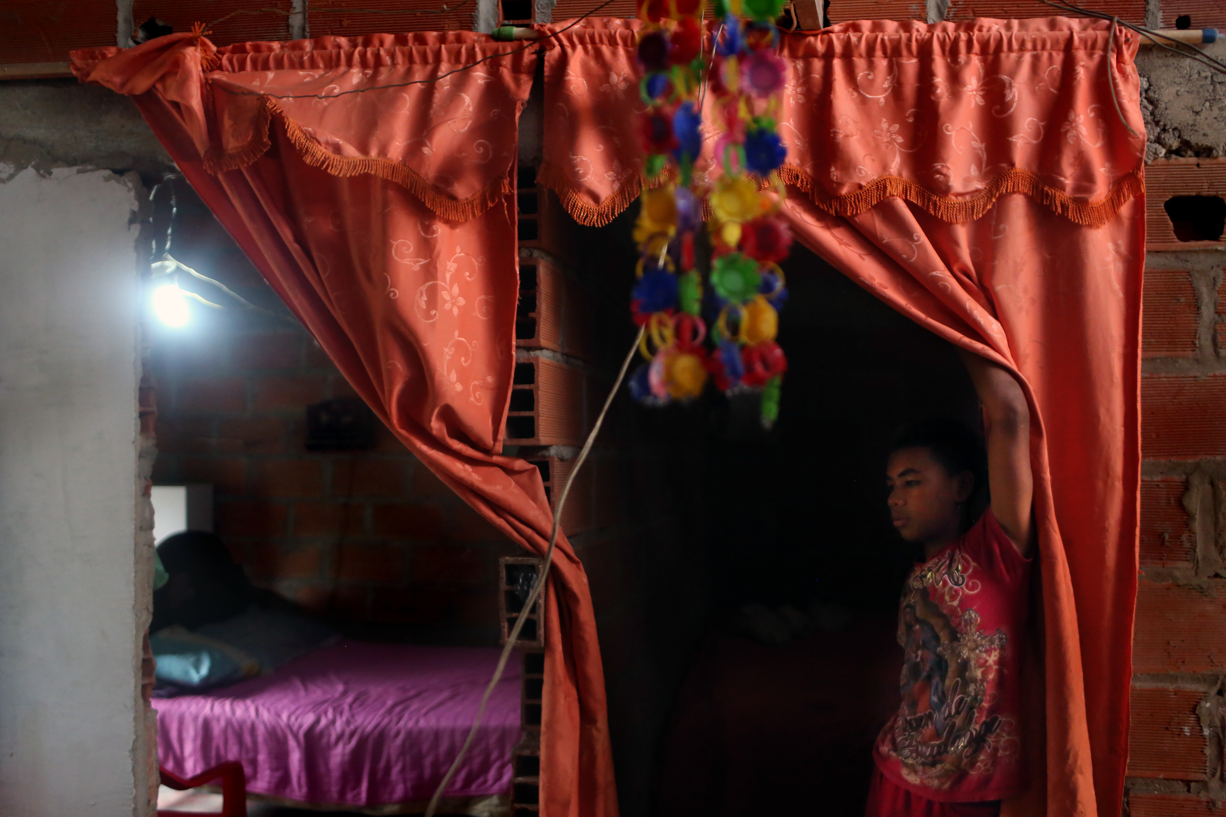 Jose Molinares Cruz stands at the door of his bedroom in Turbo which he shares with sister, Paula Molinares, 10, who is currently being treated for Guillain-Barre in Montería, Colombia on February 17, 2016. Fears of the Zika virus that is spreading across the Americas have been linked to birth defects, but health experts believe the sudden rise in Guillain-Barre cases may also be connected.
