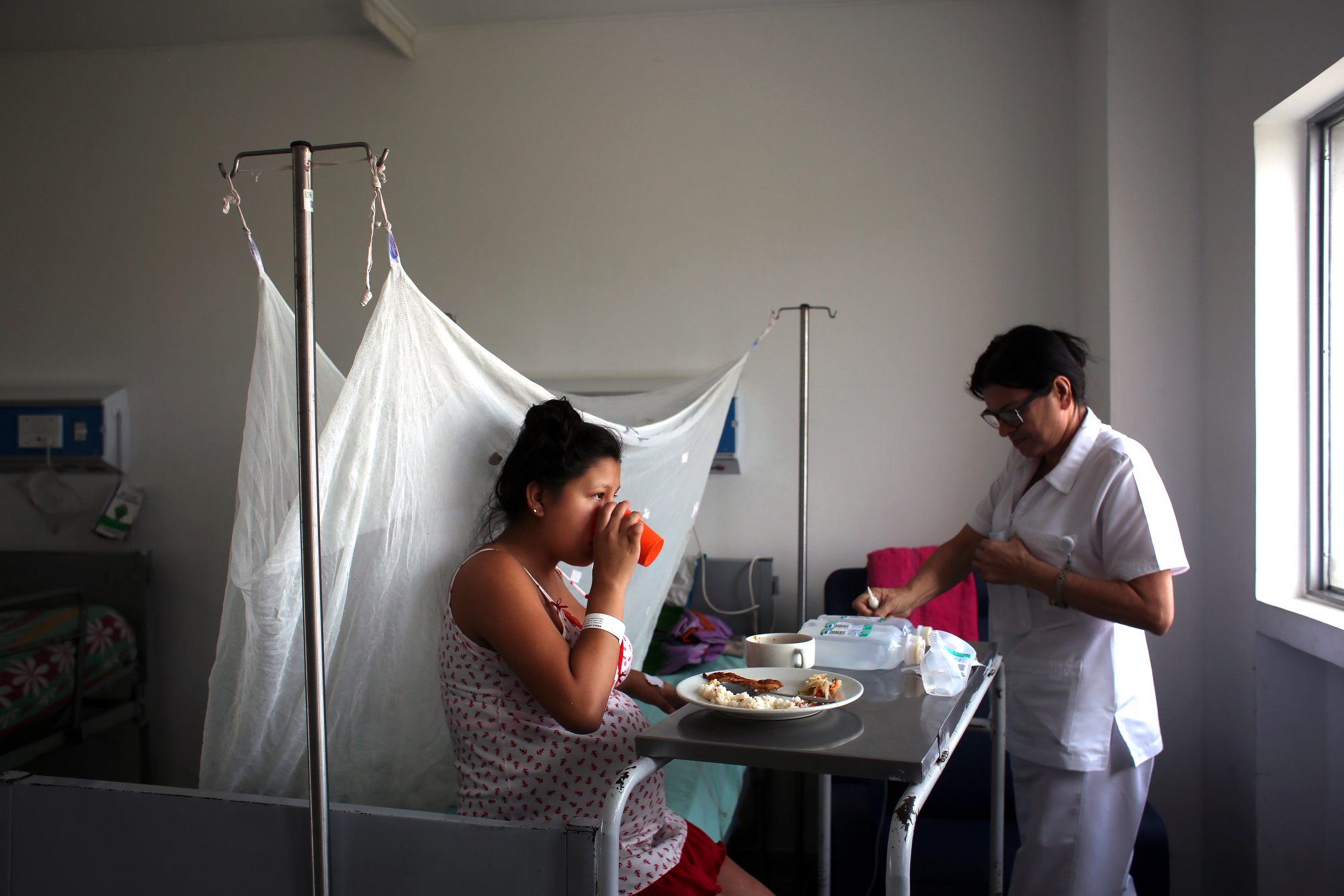 Pregnant woman Paola Andrea Escalante, 17, infected by the Zika virus eats lunch while being attended at the Hospital Universitario Erasmo Meoz in Cúcuta, Colombia, on February 4, 2016. Doctors say Escalante's baby is not infected with the virus.
