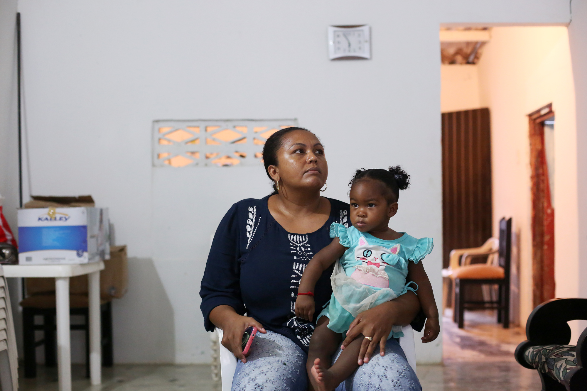 Lilliana Zuñiga Ayarza sits at her home with daughter Isabella Murillo remembering her mother Bellarmina Ayarza Garcia who is one of three recent deaths tied to Guillain-Barre in Colombia on February 16, 2016.