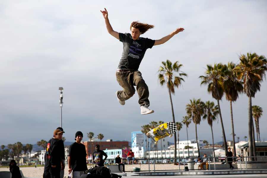 Ethan DeMoulin on one of many attempts to jump over a gap at Venice Skate Park on May 7, 2019, in Los Angeles, California. The skatepark is one of the ones in the world located on a beach.