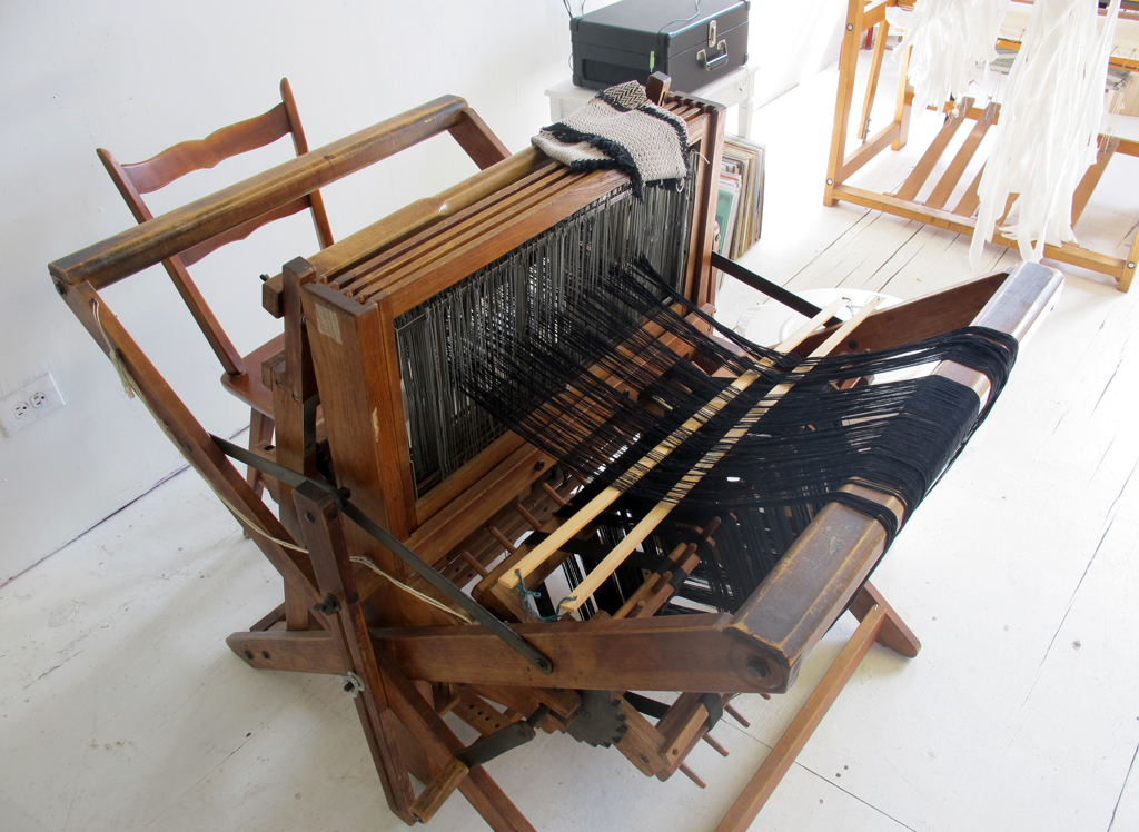 Her second loom was a meaningful gift from her college, handmade and patented by Mr. Gilmore in the 1920's. She says she will never part with it.