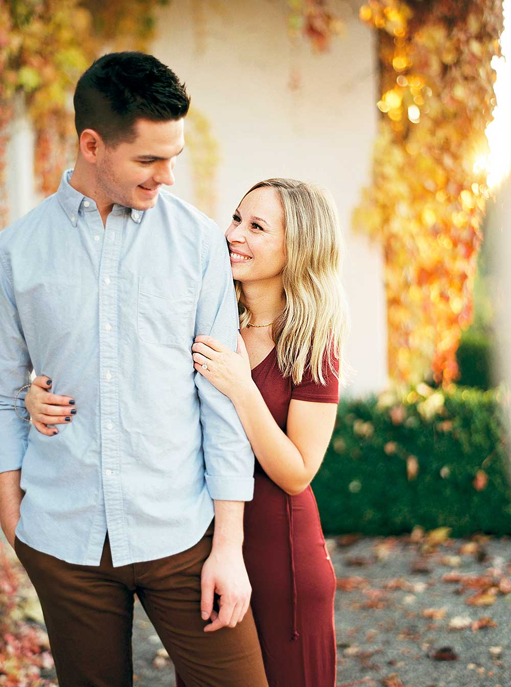 Couple smiling during engagement session.