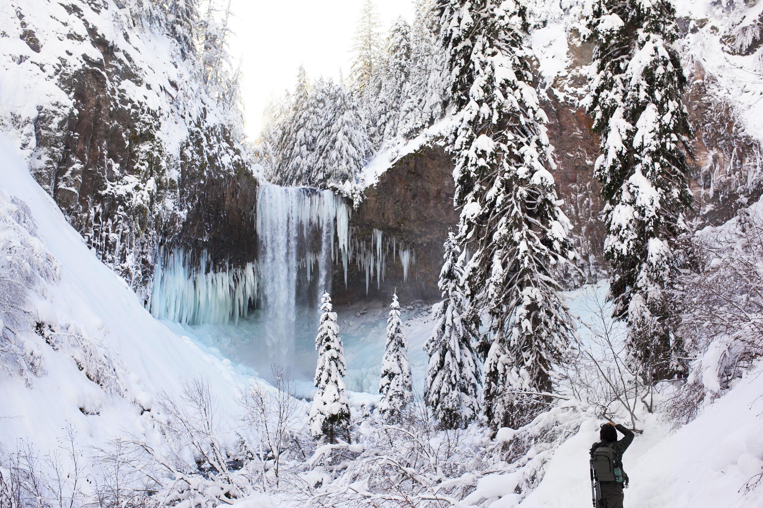 Derek Gaumer photographing the beautiful frozen Tamanawas Falls