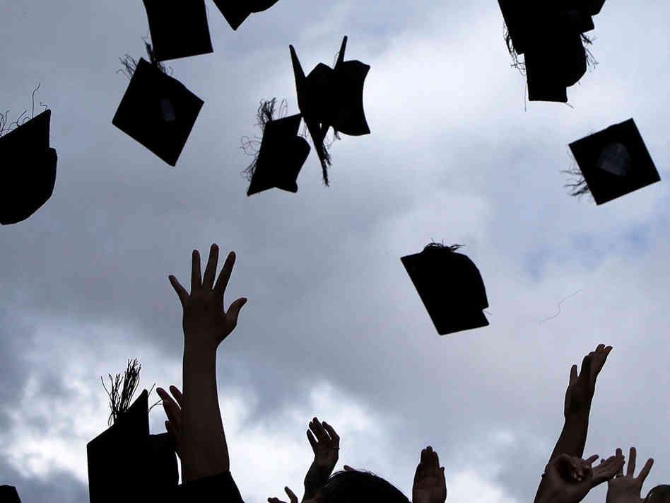 graduates-throwing-hats.jpg