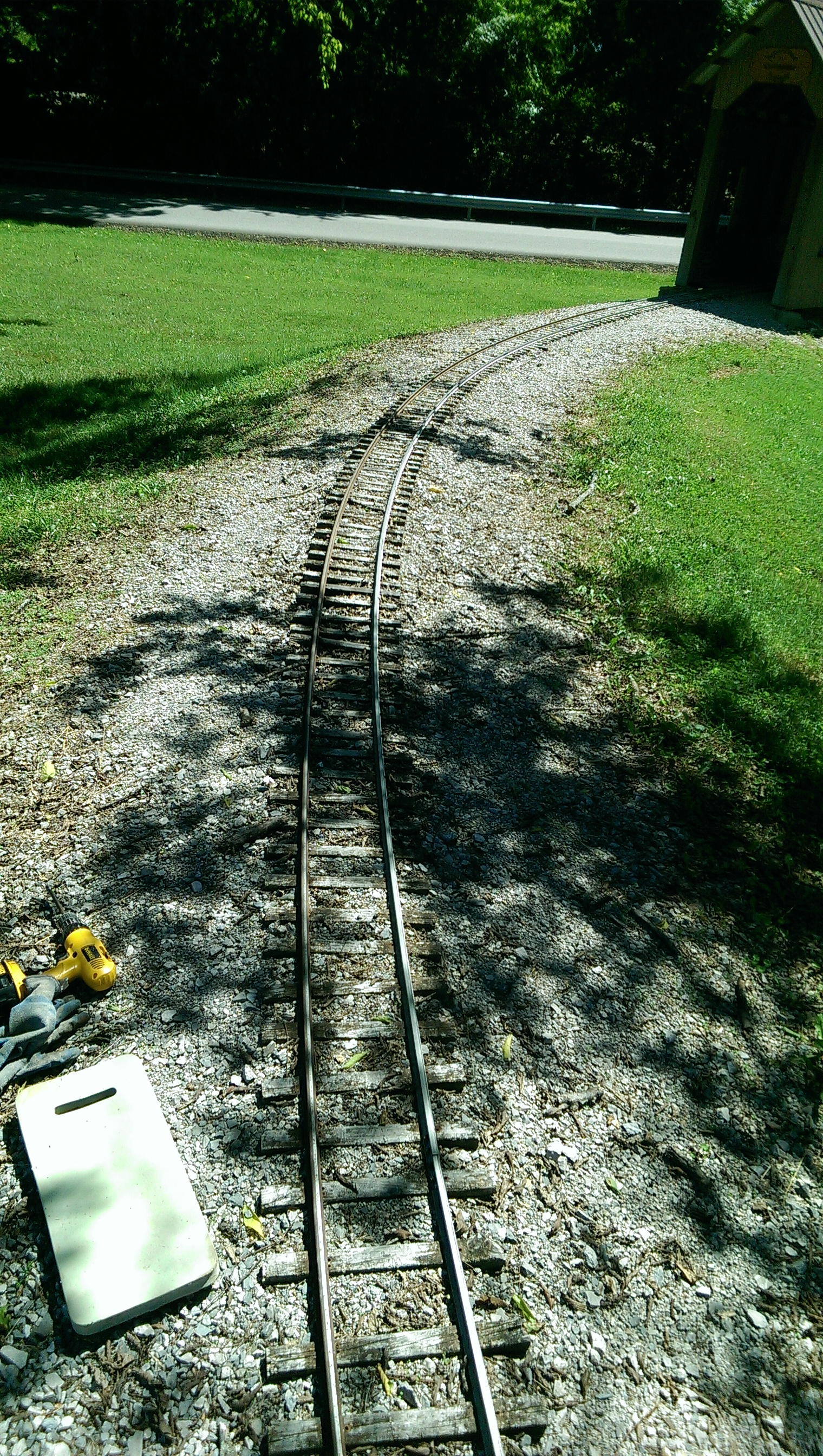 Photo taken before repairs. This section of track is just before the Lower Loop covered bridge. This section of track sits under some very large trees which causes ties to degrade quicker then other areas of the layout.