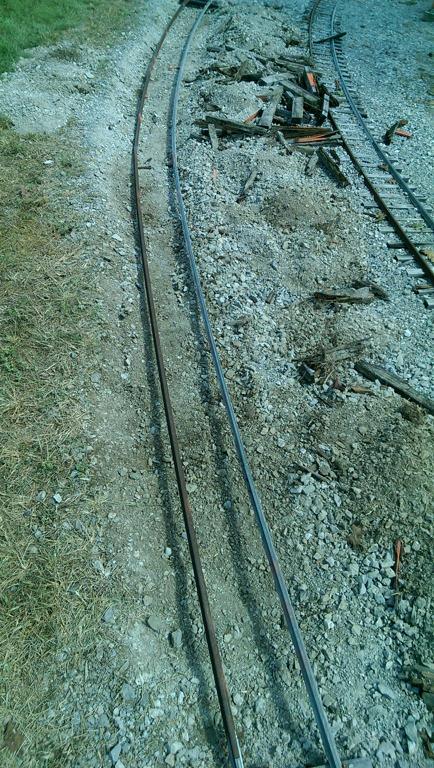 All the old ties have been removed from this section and ready for a new set of plastic and wood ties. This section of track is also located under some large trees, which causes the ties to deteriorate more rapidly then other areas.This section's repairs should be completed next work day.