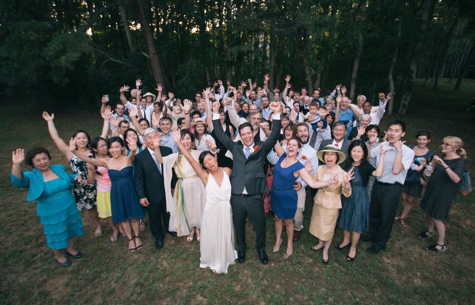 The entire wedding party including the bridge & groom's families and all friends