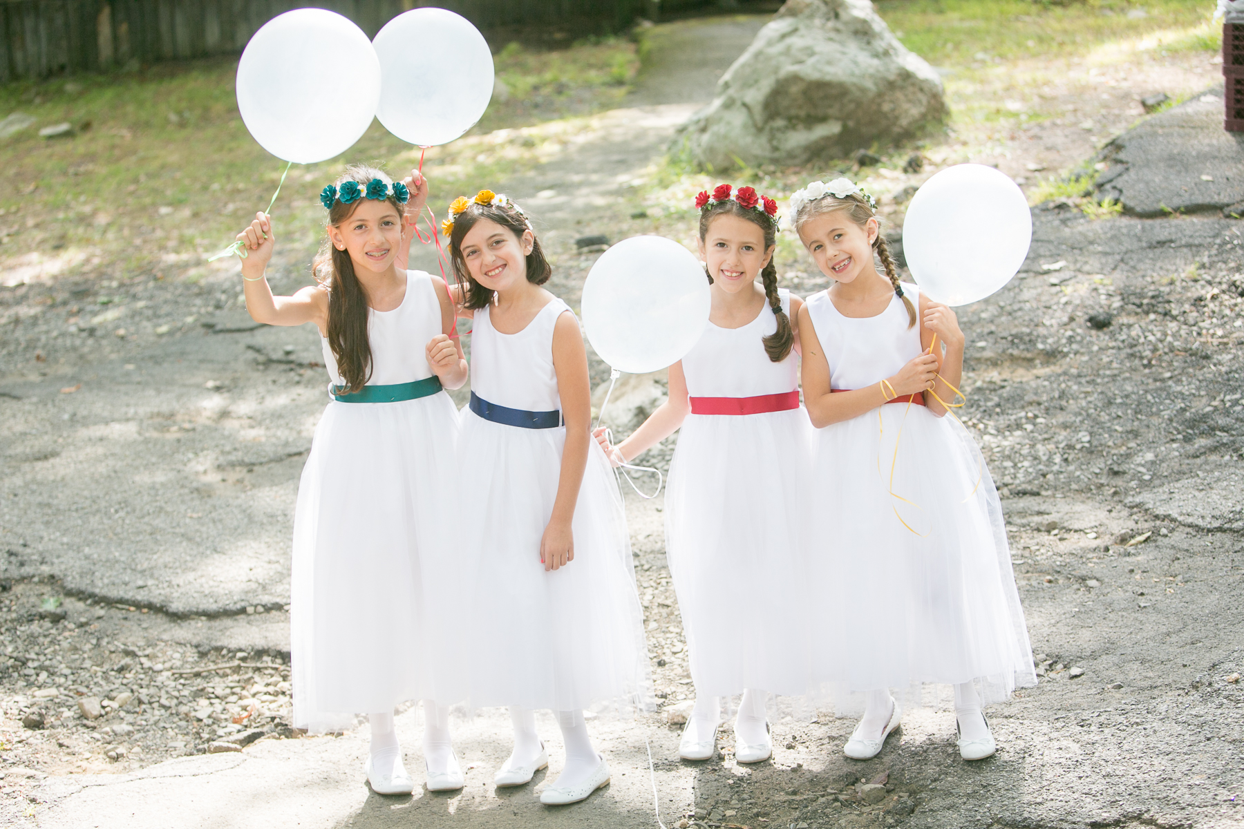 Girls in white dresses before the wedding ceremony