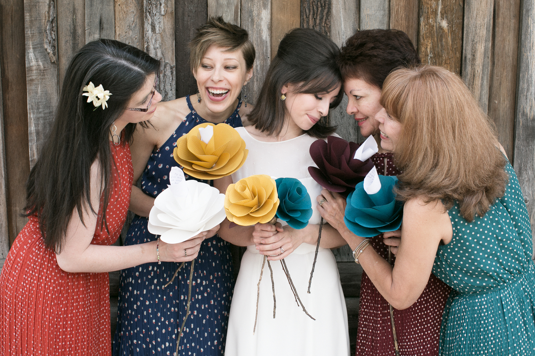 The bride and her bridesmaids before the ceremony holding custom bouquets