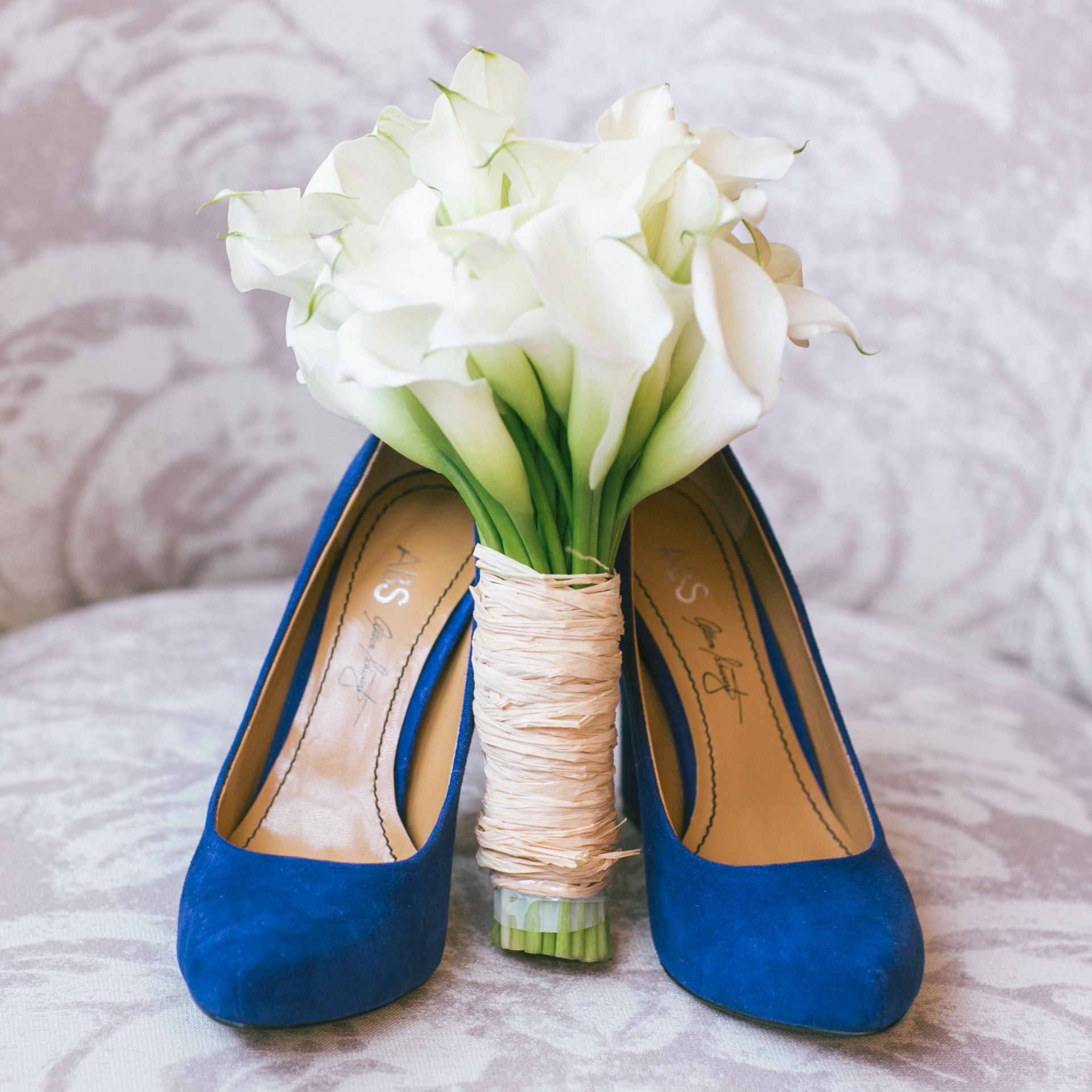 The bride's wedding shoes and flower bouquet
