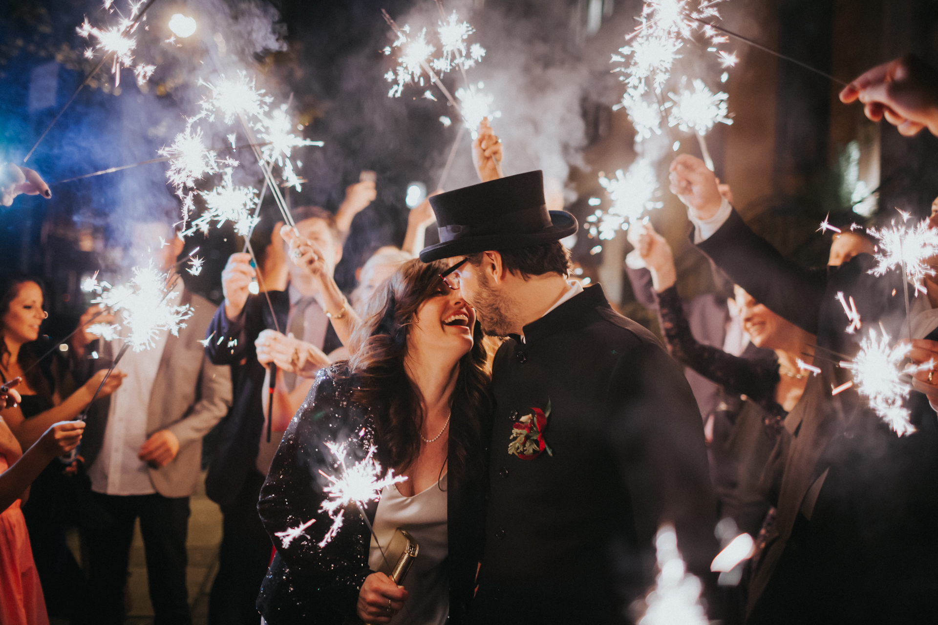 The bride and groom enjoying their send off with sparklers