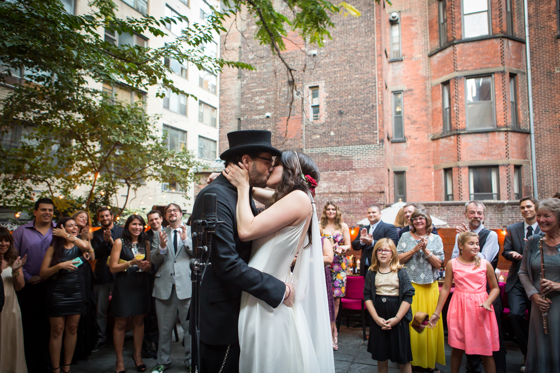 The bride and groom kiss for the first time during their wedding ceremony
