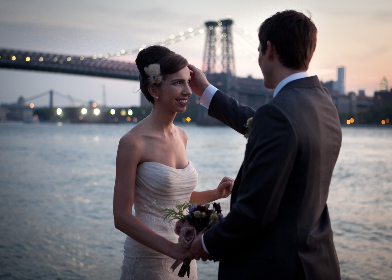 The bride and groom upon first seeing each other before the ceremony, during sunset on the Hudson NYC