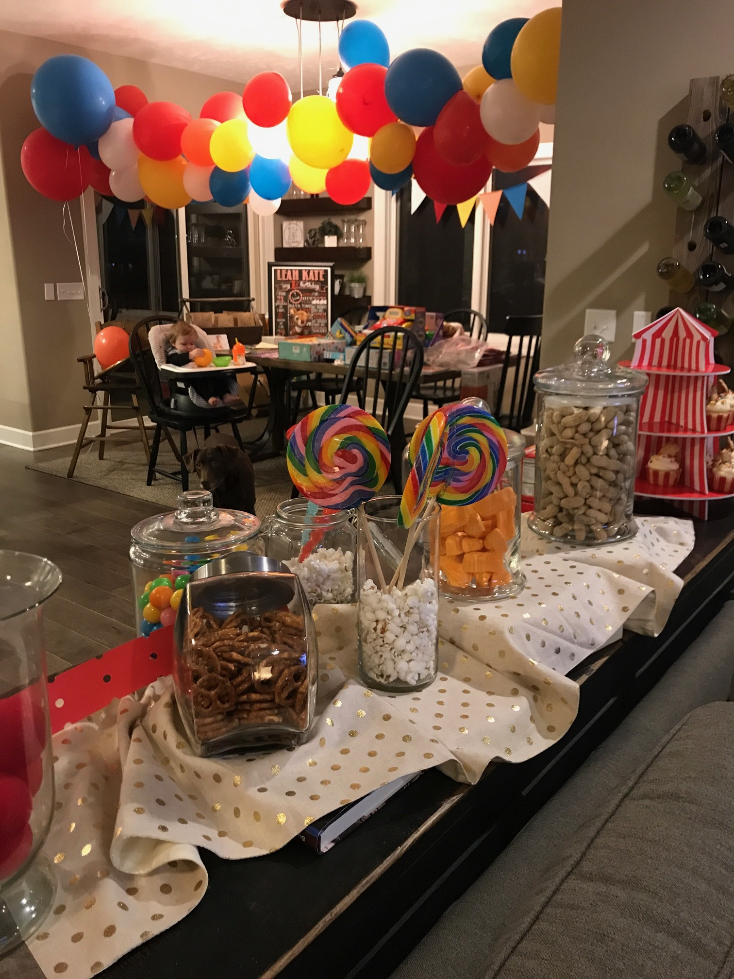 """Bad iphone pic of the balloon garland, plus cute baby eating dinner equals a """"good enough"""" photo for a blog."""