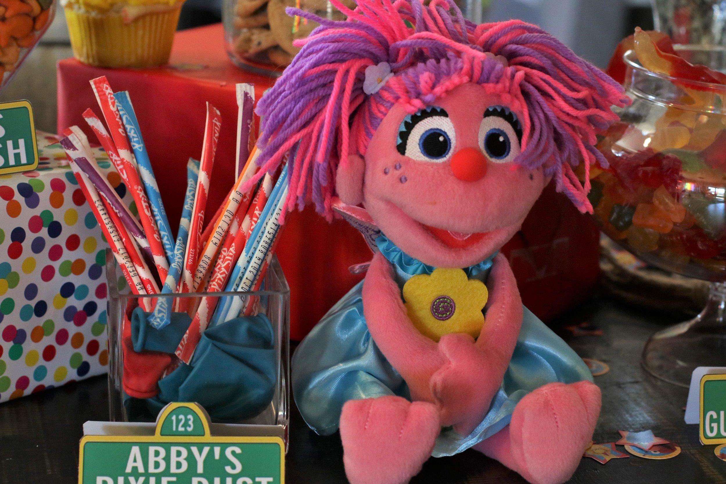Abby with her Pixie Stix on the Candy Table.