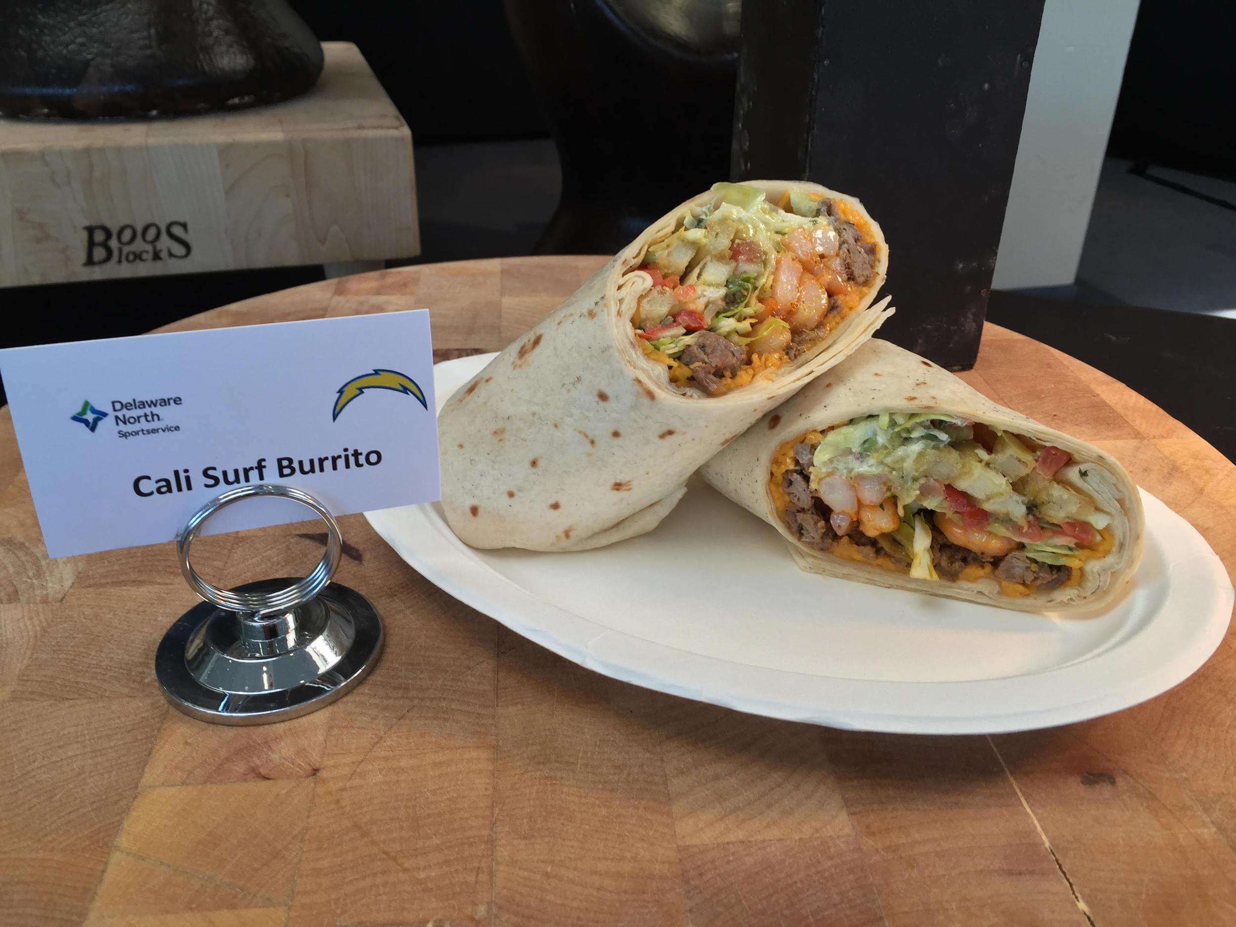 Cali Surf Burrito   – shrimp, beef, potato fries, cabbage, pico de gallo, guacamole, salsa, sour cream and cheese