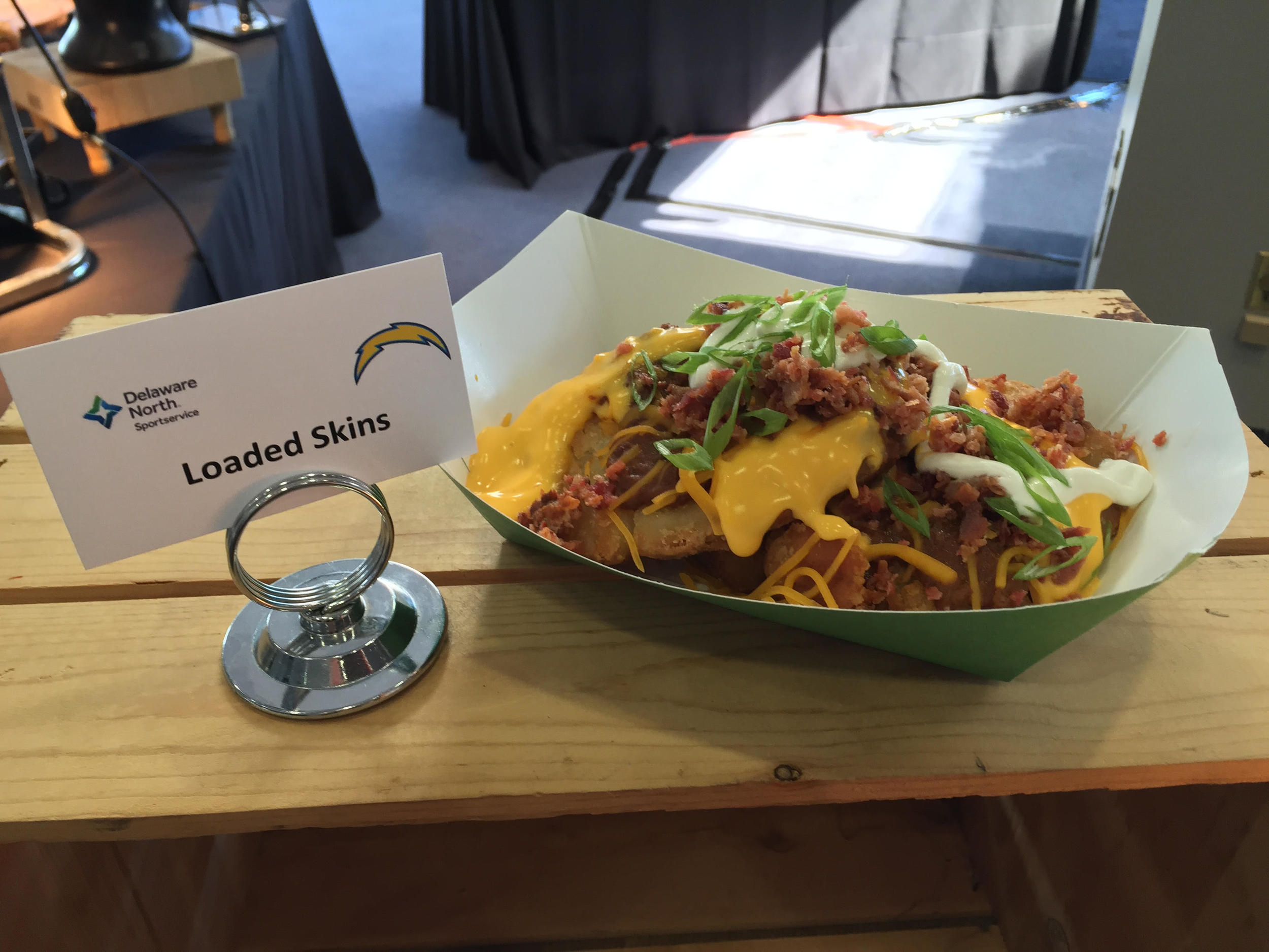 Loaded Skins   – smash potatoes with cheese, bacon bits sour cream and chili