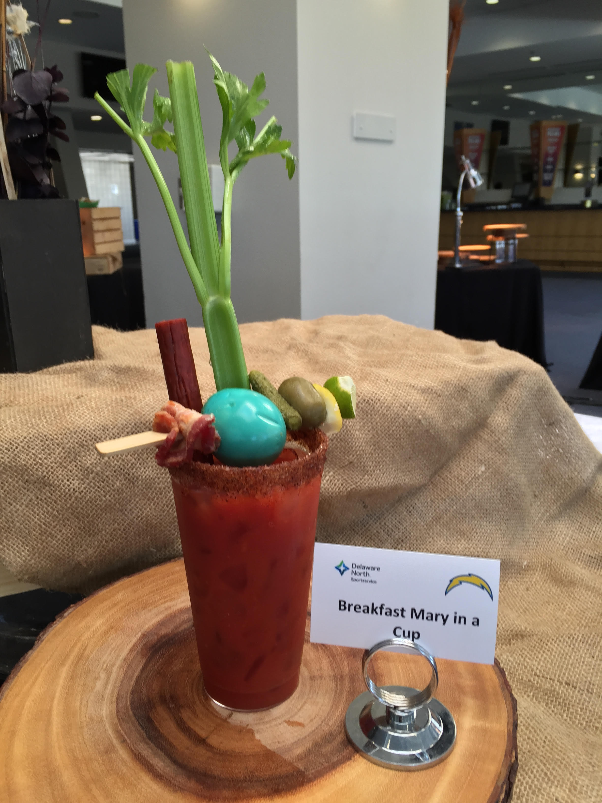 Breakfast Mary in a Cup   – spicy bloody Michelada mix, bacon on a stick, celery, pickled egg and olives