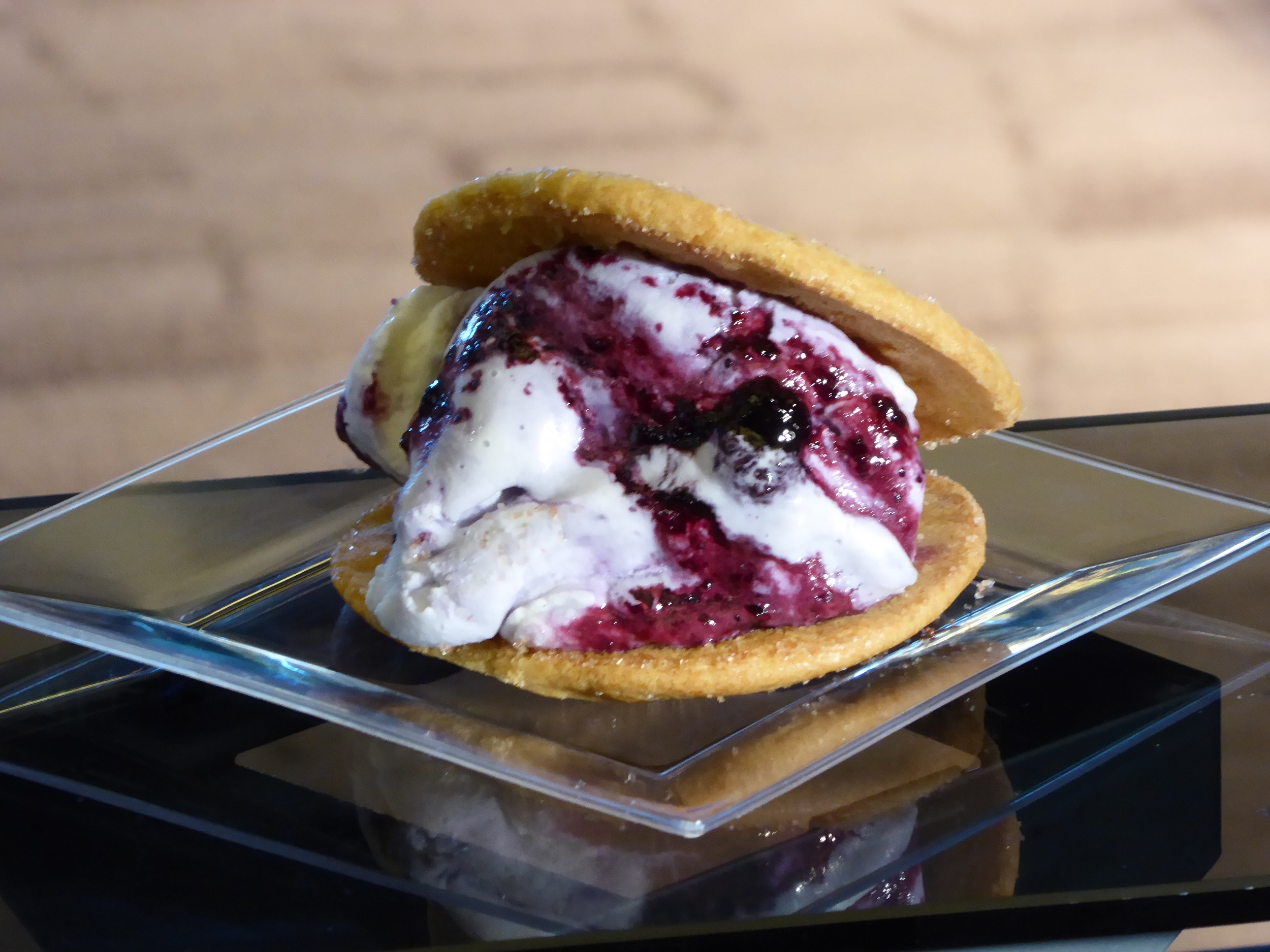 Gelato cookie sandwiches - blueberry cream gelato stuffed between two snickerdoodle cookies which can be found on the main concourse of the stadium