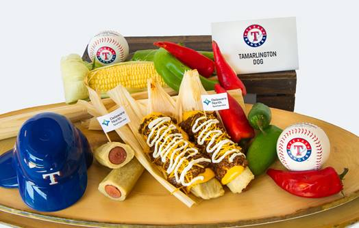 ·    The TamArlington Dog -  We have taken the hot dog out of the bun, and serving it as a tamale topped with chili and nachos cheese.