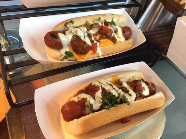 Taco Dogs - spicy beef chili, cheese, spicy tomato salsa and lime crema.