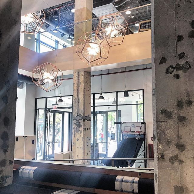 At @peetscoffee grabbing a tea  and a quick minute to think. Peekaboo shot of the #custom #pendantlights we developed and produced for @capitalonecafe Loving the summer light bouncing around in this open atrium. @jkosy @iaarchitects #lightdesign #design #different #lightlite