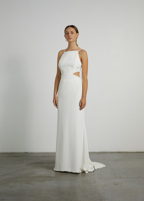 wedding dress designers - The Cora gown is ultra-sleek and minimal, with a strong personality. The high square neck and waist cut-outs are bold and paired with the rouleau straps, - prea james bridal