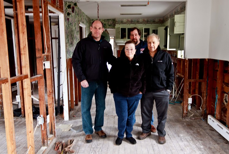 Mr. Vasselli, a WWII and Korean War veteran, pictured with his wife, Jeff Cantor and Paul Schaflin prior to the demolition of their home ravished by Superstorm Sandy.