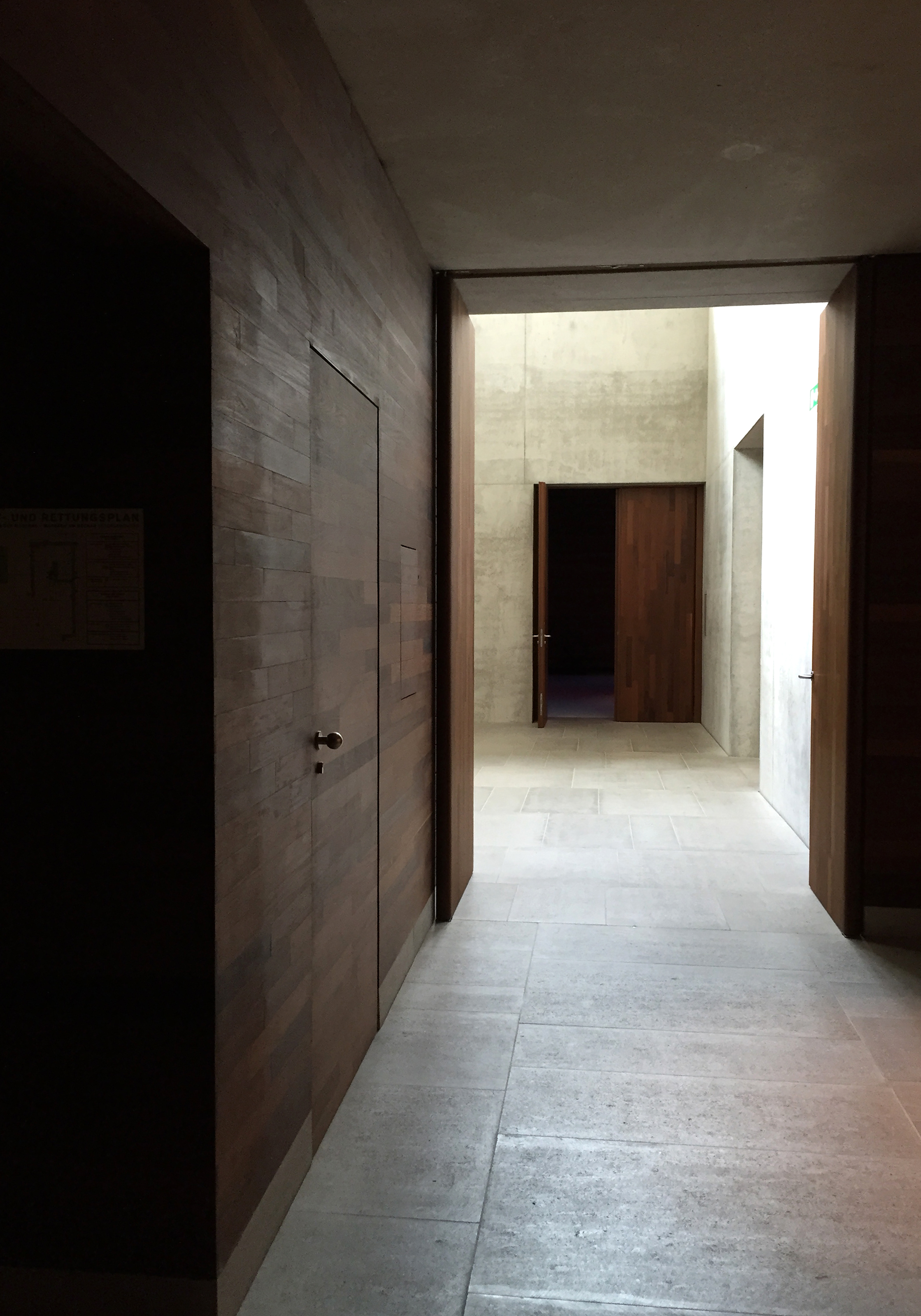 Warm timber walls and doors offset some of the coolness of the required temperature of 18 degrees while fair-faced concrete reflects light and provides contrasting planes to draw visitors through from dark spaces into light.  Circulation routes around the museum are entirely arbitrary.